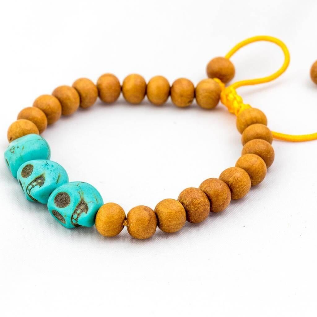 Turquoise Skull Wooden Wrist Mala -thamelshop-mens beaded jewelry-tibetan mala shop-tibetan mala bracelets-how to make a wrist mala-wrist beads for guys-wrist mala-bodhi seed wrist mala-impermanence mala-dragons blood mala-japanese wrist mala-mens sandalwood bracelet-adjustable mala beads- wrist jewellry- hand jewellry